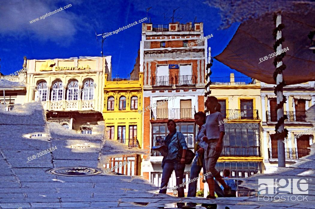 Stock Photo: Reflection of buildings and pedestrians in Plaza de San Francisco.