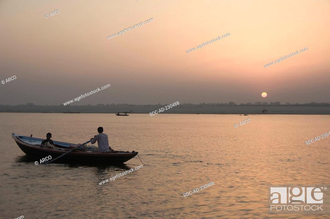 Stock Photo: Sunrise at river Ganges, Varanasi, Benares, Uttar Pradesh, India.
