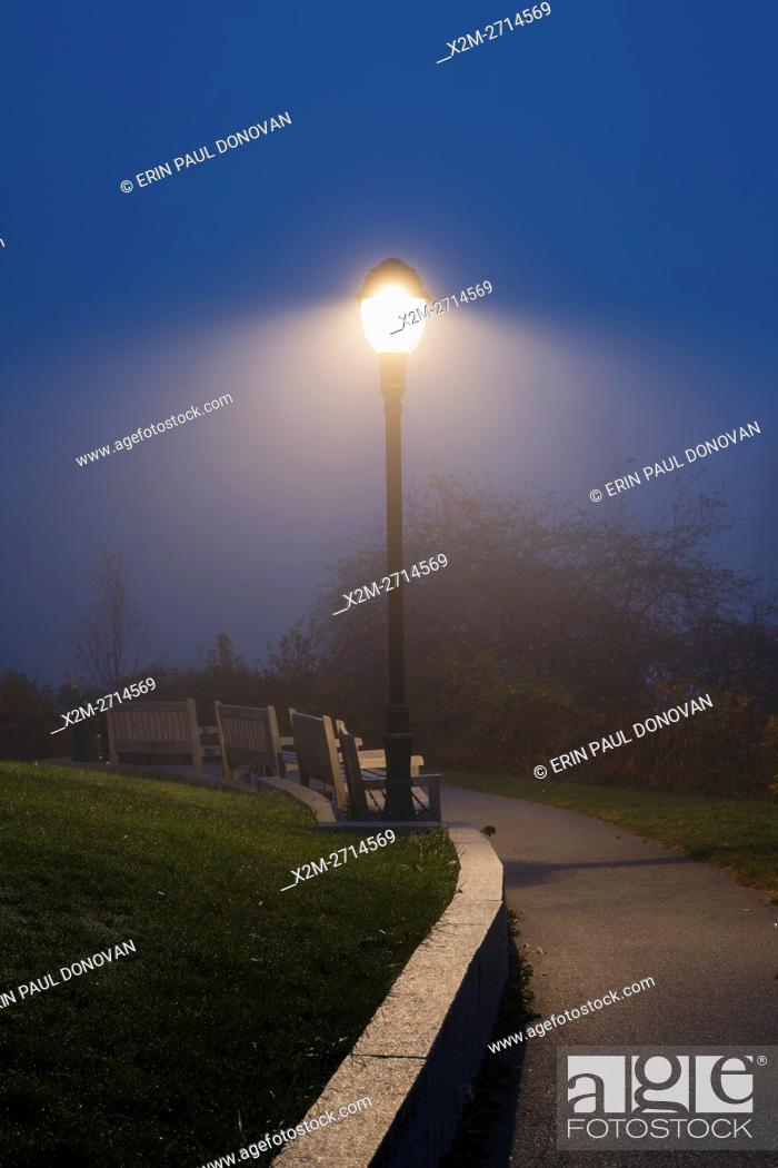 Stock Photo: Foggy morning at Camden Harbor in downtown Camden, Maine during the autumn months.