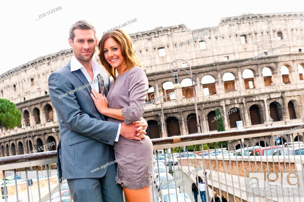 Stock Photo: Couple in front of the Roman Colosseum.