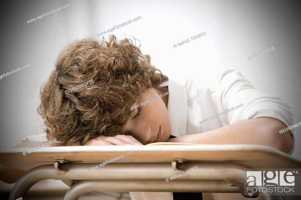 Stock Photo: Boy asleep in classroom.