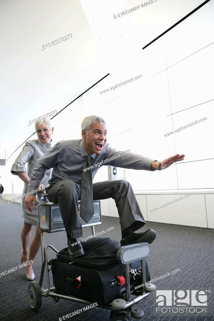 Stock Photo: Mature couple having fun in airport.