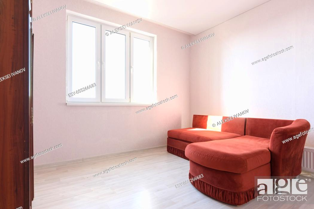 Stock Photo: Interior of a bright room with an old sofa in the bedroom.