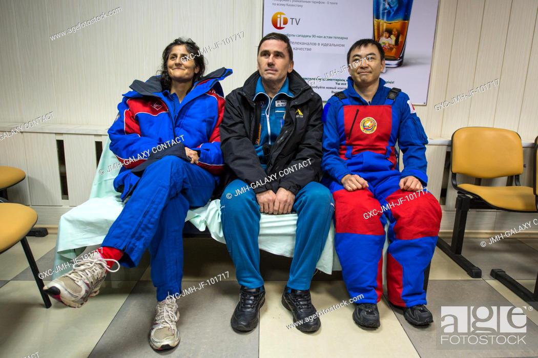 Stock Photo: Expedition 33 crew members; Commander Sunita Williams of NASA, left, Flight Engineers Yuri Malenchenko of Russian Federal Space Agency (Roscosmos).