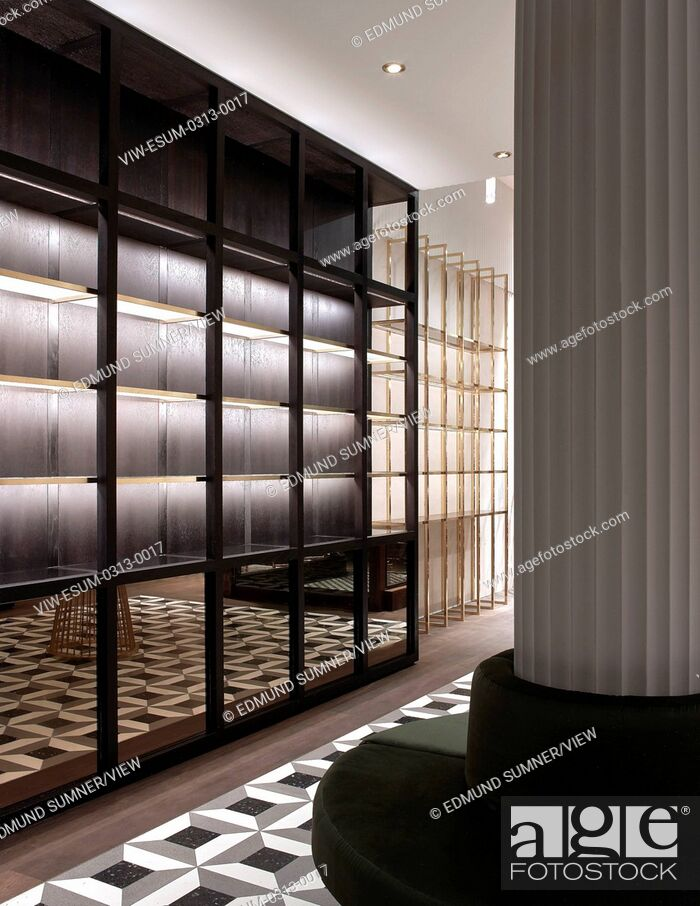 Stock Photo: In this store blackened oak shelving is dissolved into a framework enabling a display that both suited the deep and narrow inter.