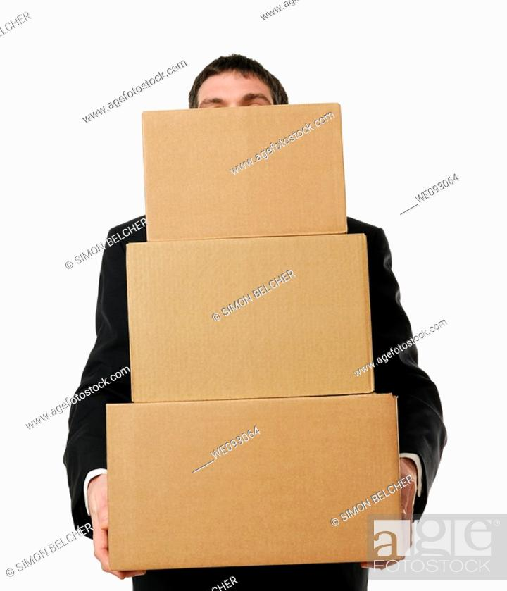Stock Photo: Businessman Overloaded with a Stack Boxes.