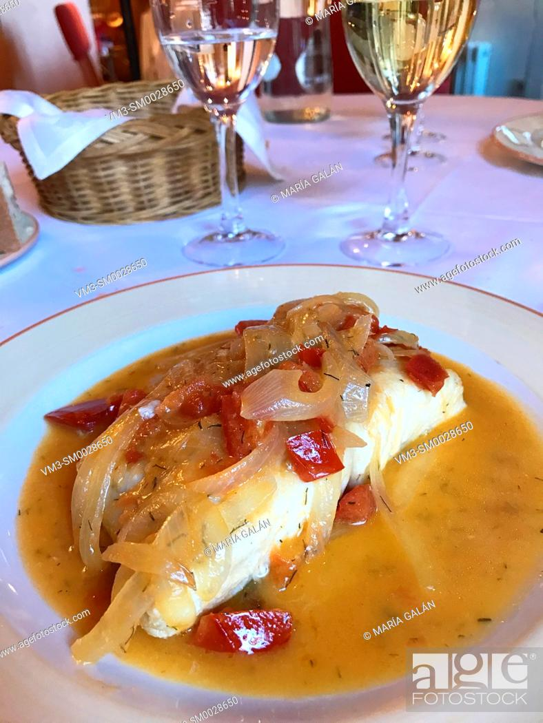 Stock Photo: Hake loin with onion and pepper. Spain.