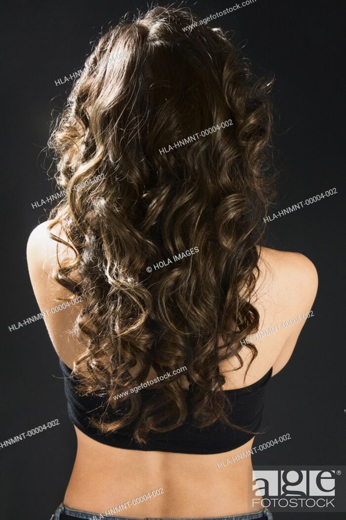 Stock Photo: Back view of young woman with long hair.