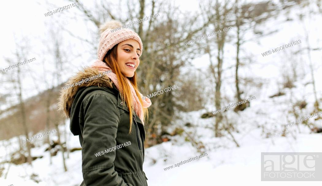 Stock Photo: Spain, Asturias, happy young woman in the snowy mountains.