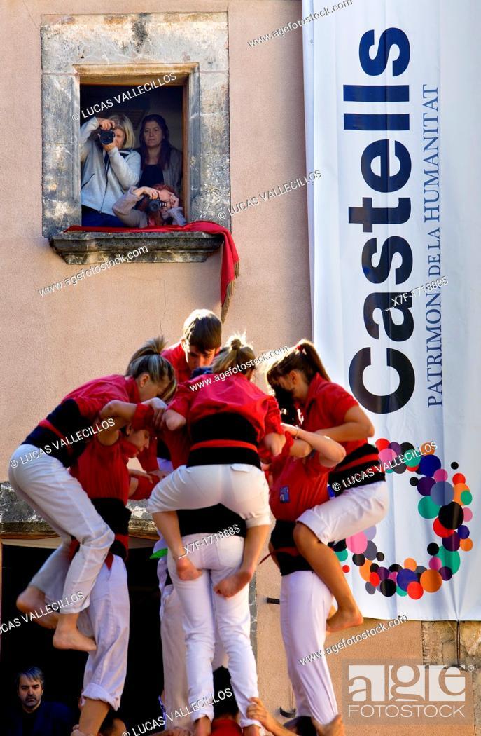 Stock Photo: Nens del Vendrell 'Castellers' building human tower, a Catalan tradition Fira de Santa Teresa, town festival  Plaça Vella El Vendrell Tarragona province, Spain.