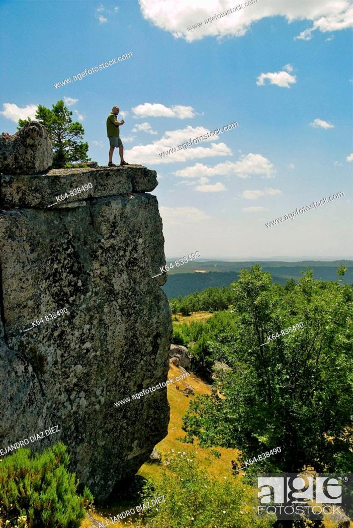 Stock Photo: Men at hte top of a rock, Canicosa de la Sierra, Burgos.