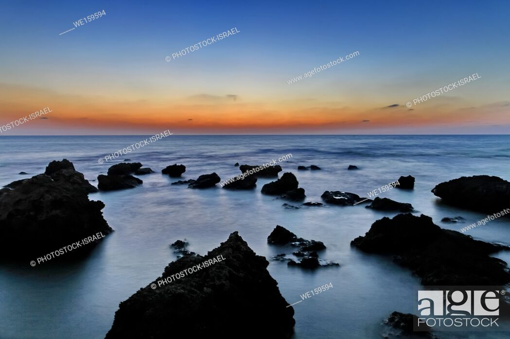 Stock Photo: stubborn rocks in water Photographed in the Mediterranean Sea, Israel.