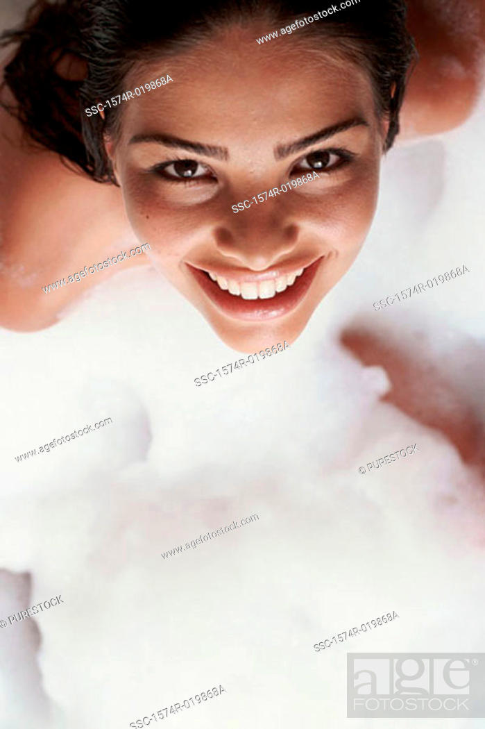 Stock Photo: High angle view of a young woman taking a bubble bath.