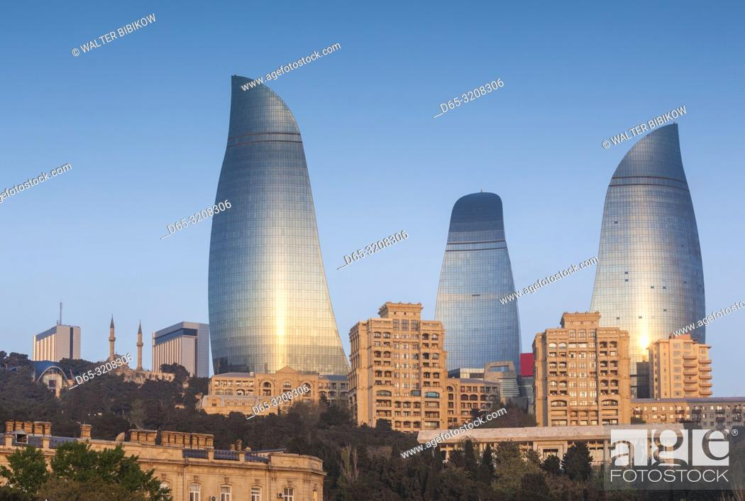 Stock Photo: Azerbaijan, Baku, city skyline with Flame Towers form Baku Bay, dawn.