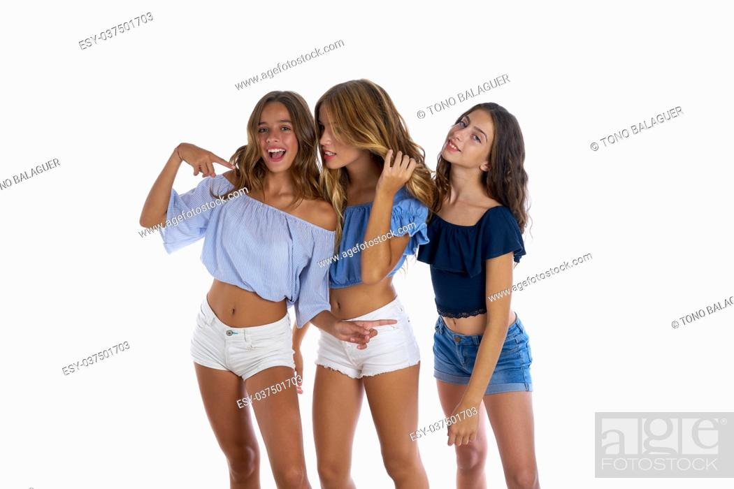 Imagen: Thee teen best friends girls happy together on white background.