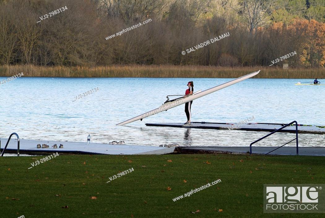 Stock Photo: canoe diverting water from the pirogue, Lake of Banyoles, girona, catalonia.