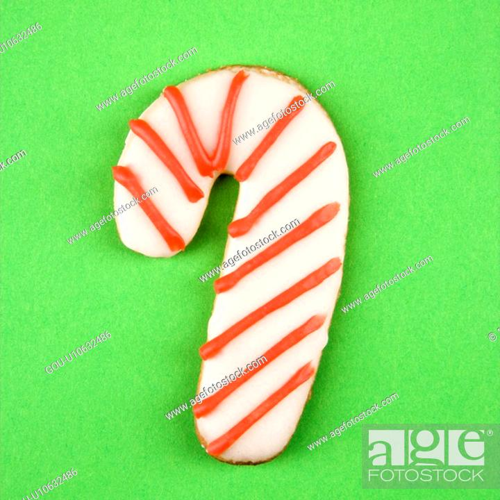 Stock Photo: Candy cane sugar cookie with decorative icing.