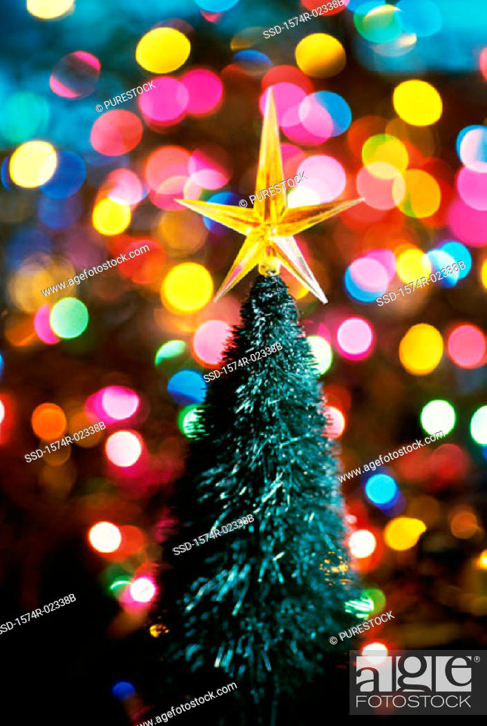 Stock Photo: Close-up of a Christmas star on top of Christmas tree.