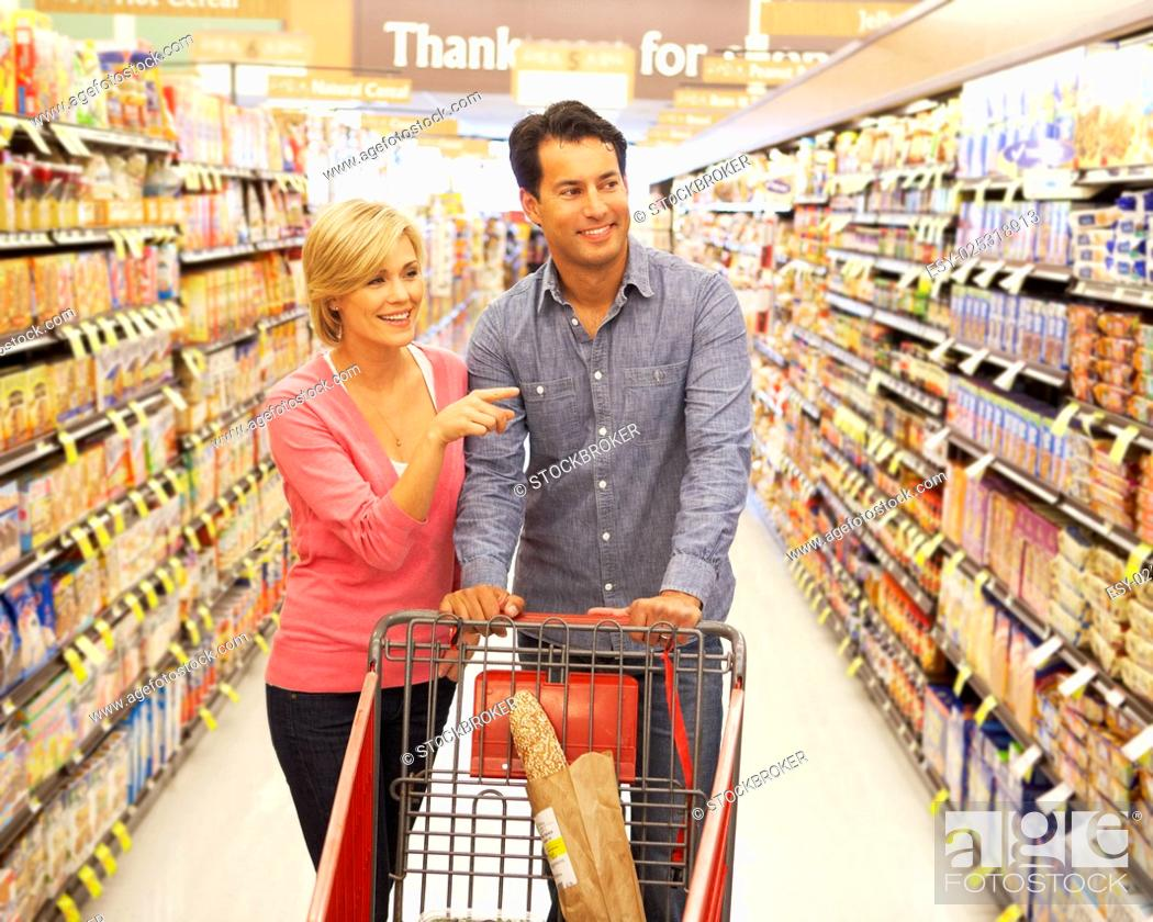 Stock Photo: Couple shopping in supermarket.