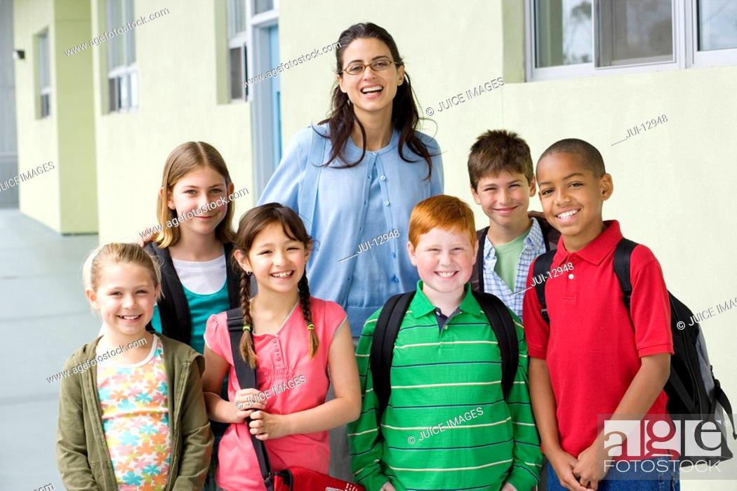 Stock Photo: School children 7-11 with teacher, portrait.