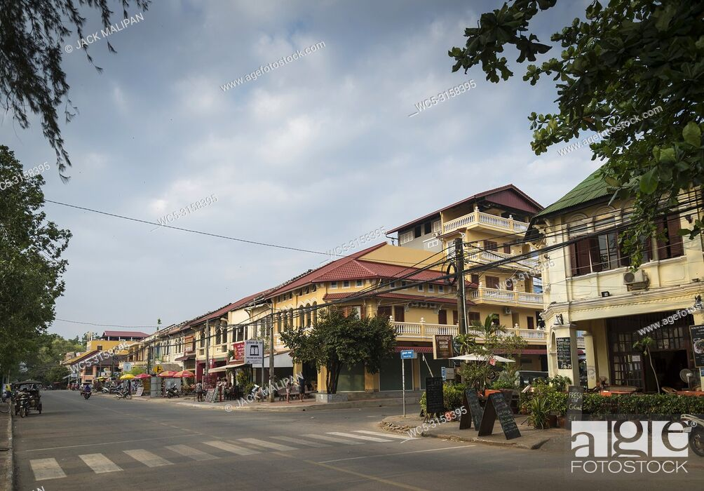 Stock Photo: old french colonial architecture buildings in kampot downtown street cambodia.
