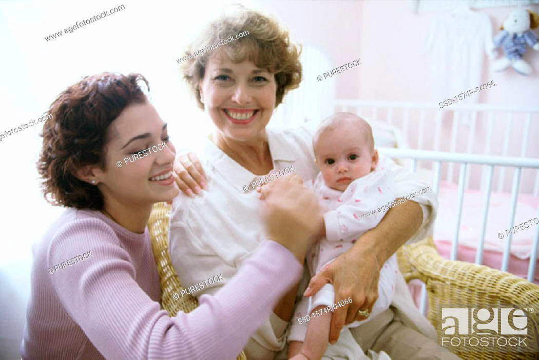 Stock Photo: Portrait of a grandmother holding her granddaughter.
