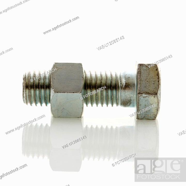Stock Photo: Nut and bolt against white background.