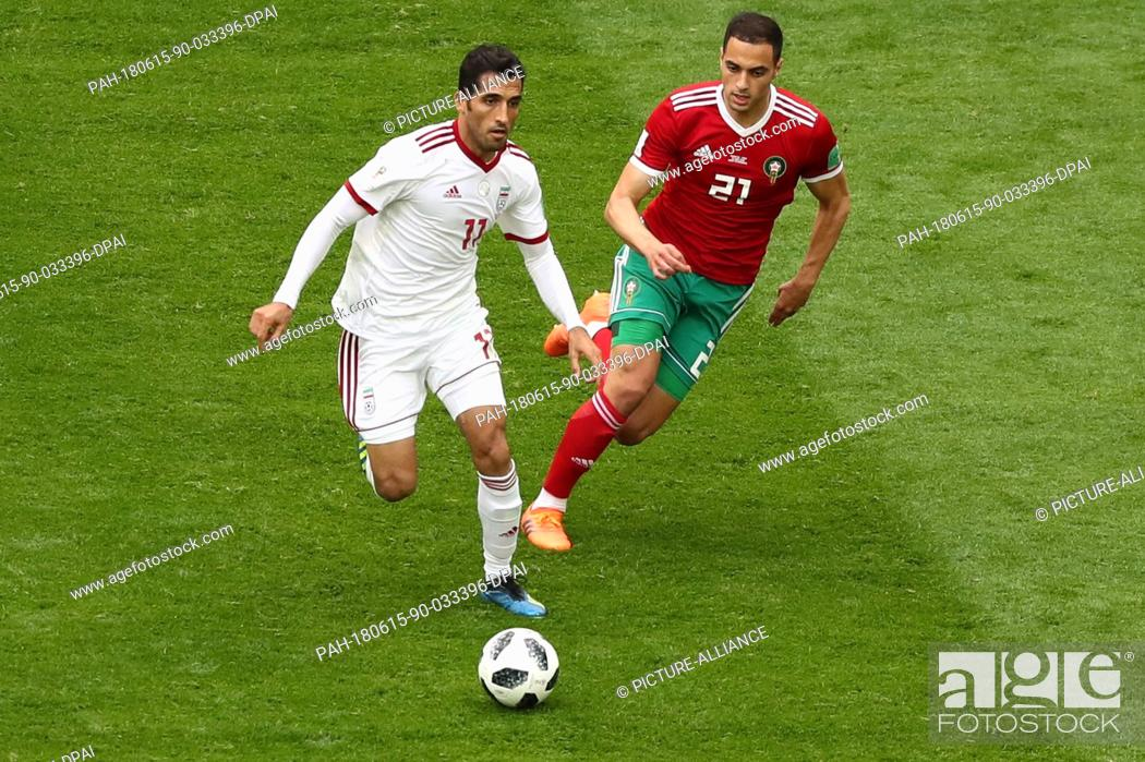 Irans Vahid Amiri L Vies For The Ball With Moroccos Sofyan