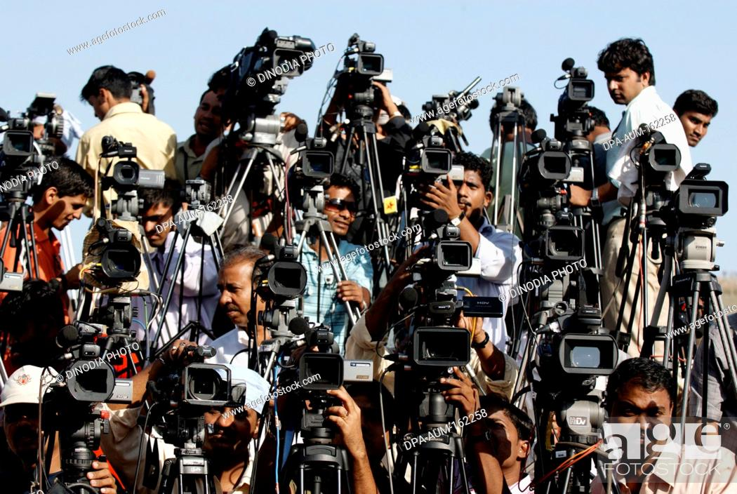 Cameramen representing different news channels electronic