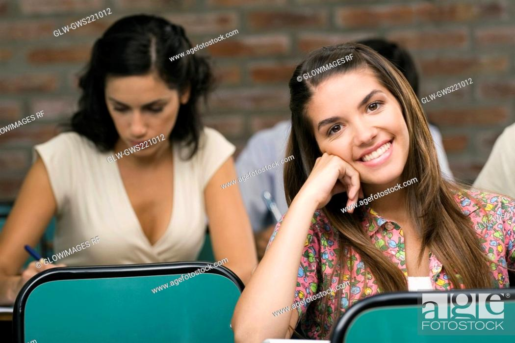 Stock Photo: University students sitting in a classroom.