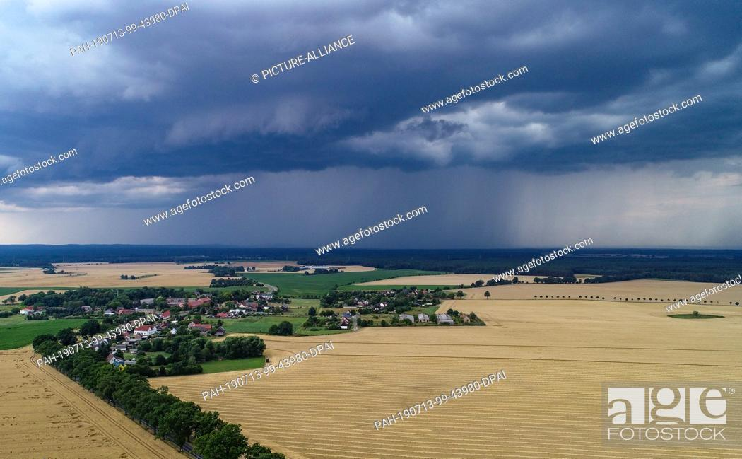 Stock Photo: 13 July 2019, Brandenburg, Petersdorf: Thunderstorm clouds are moving over the landscape in the district Oder-Spree (aerial photo with a drone).