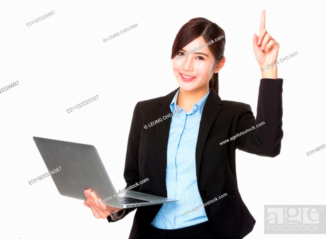Stock Photo: Young businesswoman use of the laptop and finger point up.