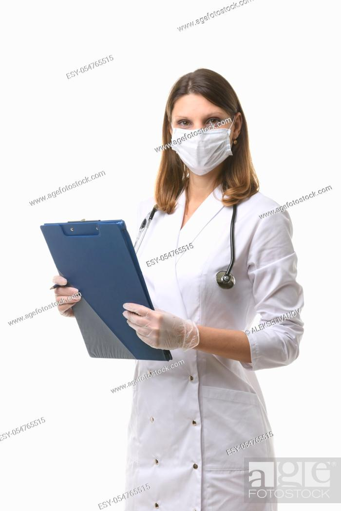 Stock Photo: Portrait of a doctor girl in a medical mask and gloves.