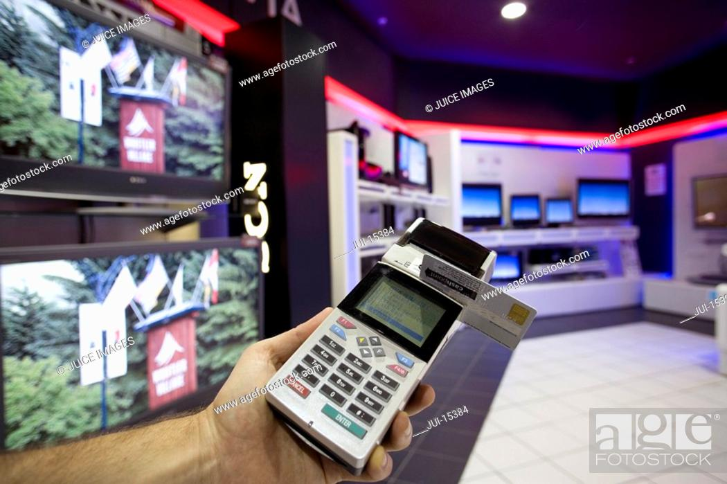 Stock Photo: Man with credit card machine in shop, close-up.