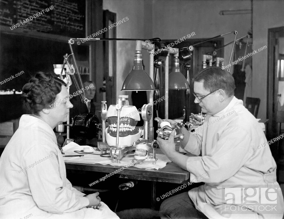 Stock Photo: Chicago, Illinois: March 21, 1928.Dr. Rudolph Schlosser at the Northwestern University Dental Laboratory explains the proper use of the Articulator which shows.