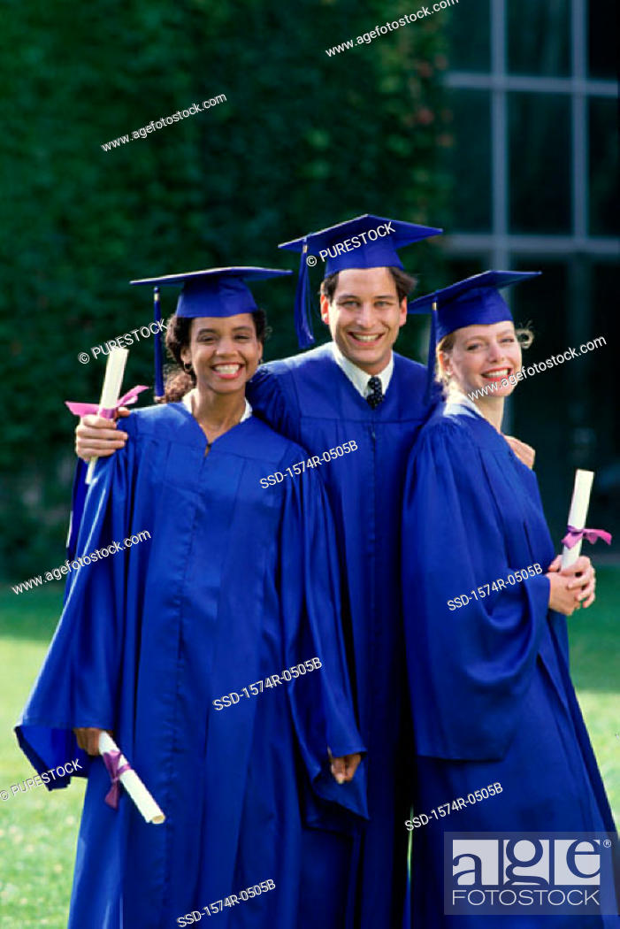Stock Photo: Portrait of a group of students wearing graduation outfits.