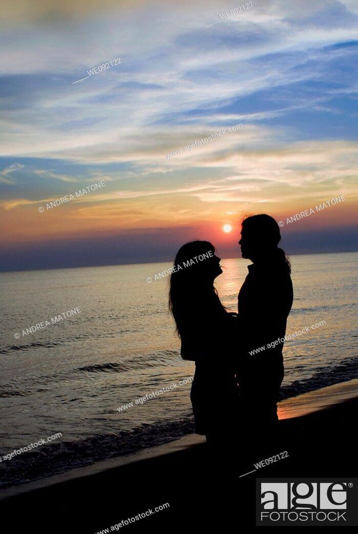 Stock Photo: Romantic couple at sunset.