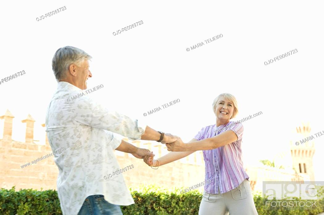Stock Photo: Man and woman holding hands.