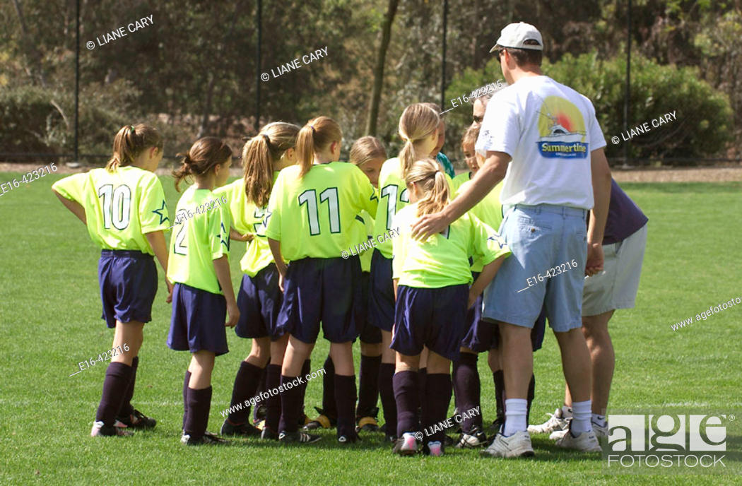 Stock Photo: coach talking with soccer team.