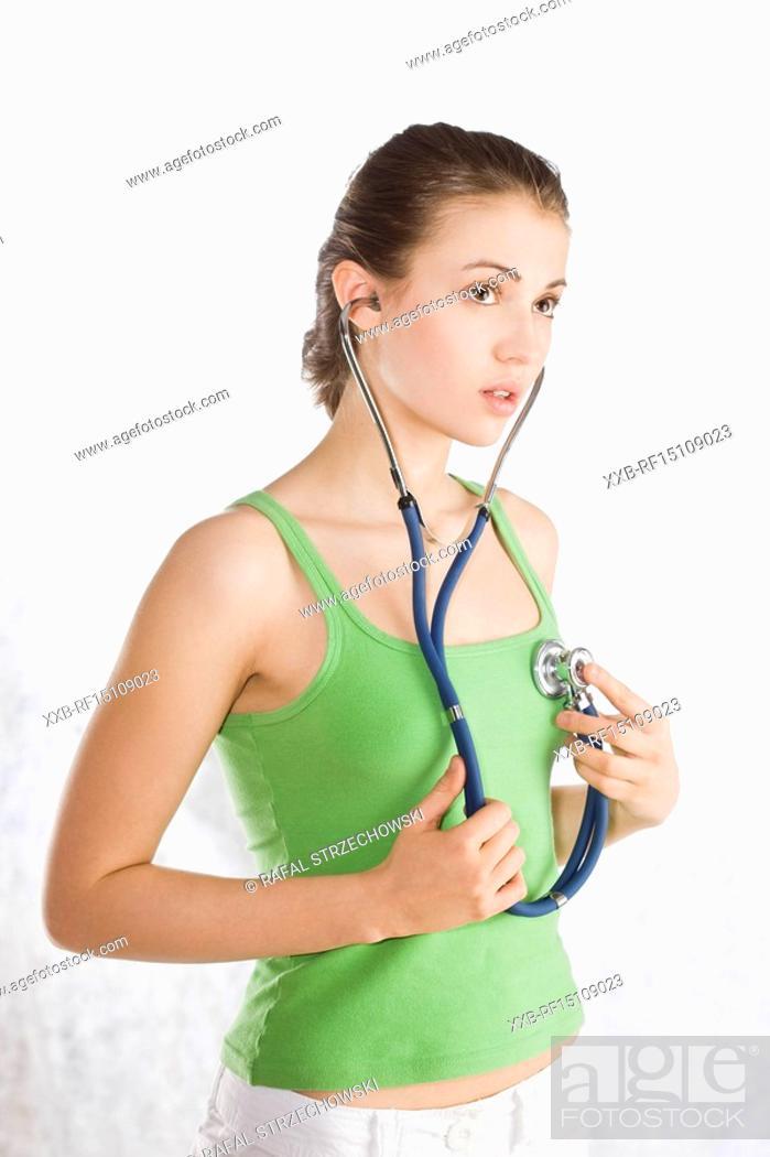 Stock Photo: woman holding stethoscope.