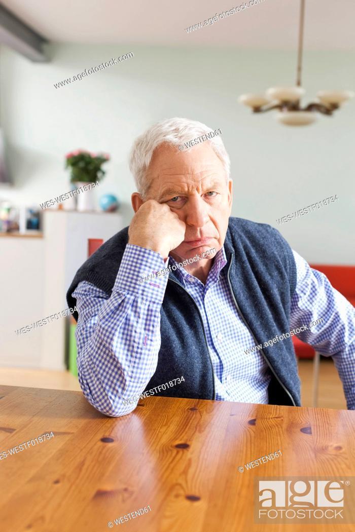 Stock Photo: Germany, Leipzig, Senior man sitting at table.