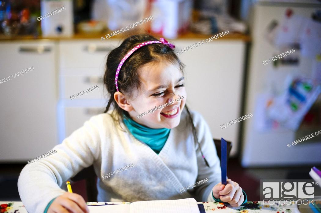 Stock Photo: Girl studies in the kitchen, laughter.