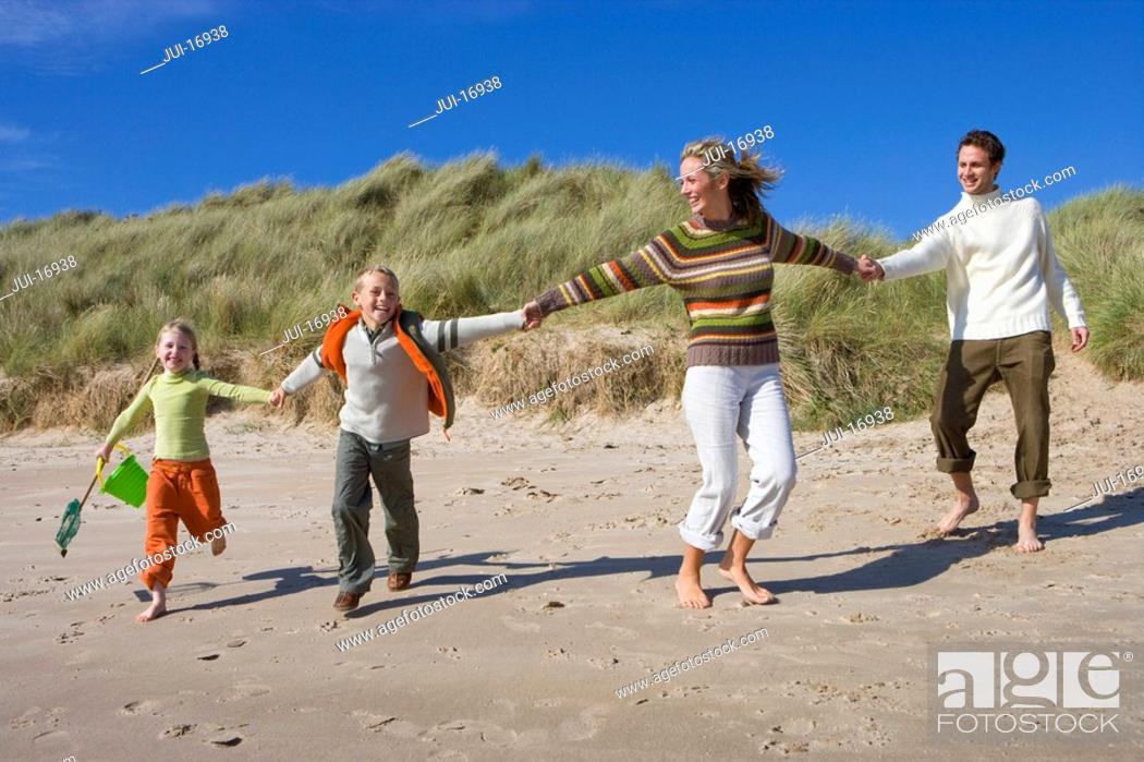 Stock Photo: Family running on beach.