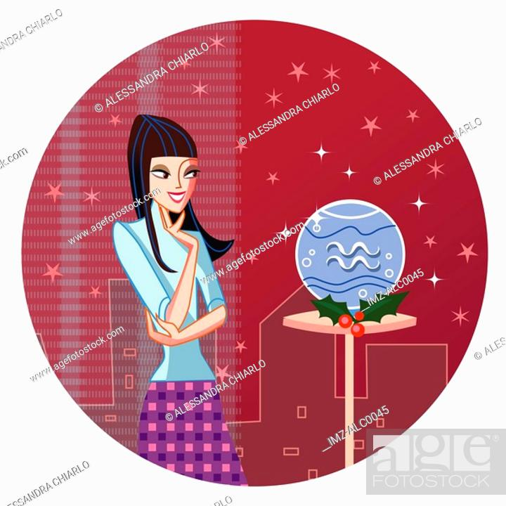 Stock Photo: An Aquarius woman looking at a crystal ball.