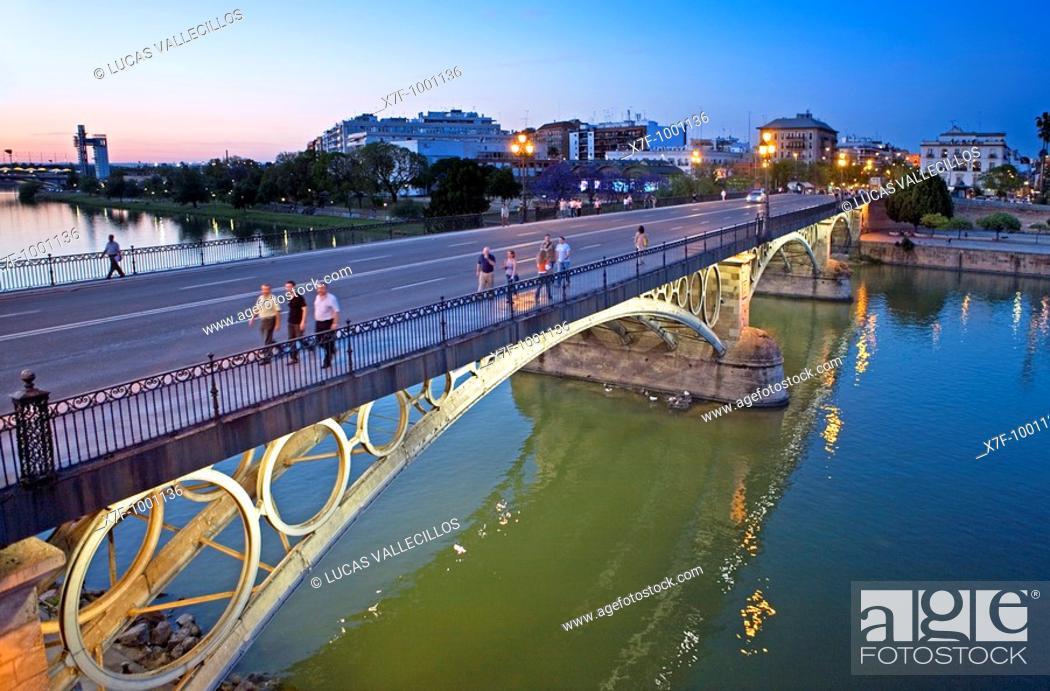 Stock Photo: Puente de Isabel II o de Triana en el río Guadalquivir  Seville, Andalusia, Spain.