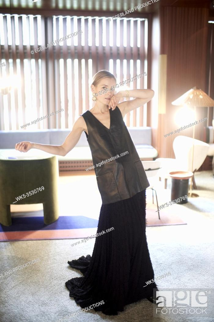 Stock Photo: Elgant woman in black attire at home.