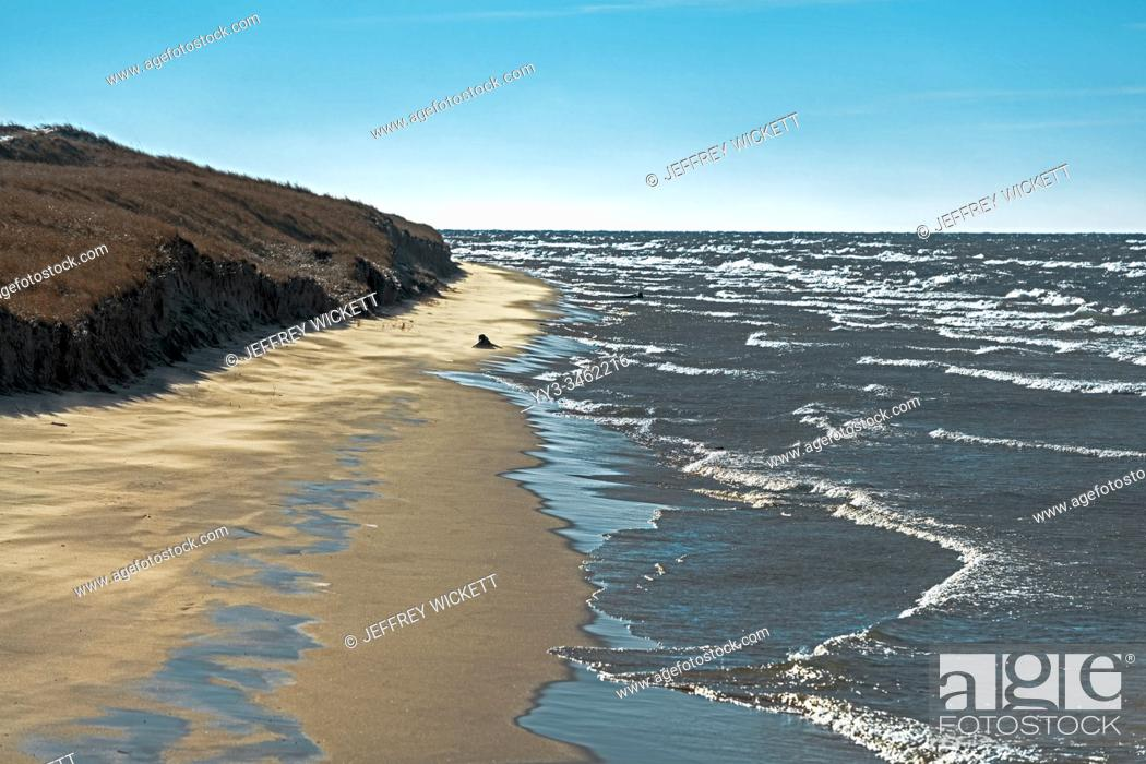 Stock Photo: Sand dunes, beach and multiple waves at Ludington State Park near Ludington, Michigan, USA. . Ludington State Park is a state park located just north of.