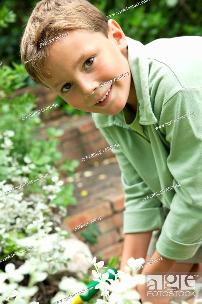 Stock Photo: Portrait of a boy gardening.