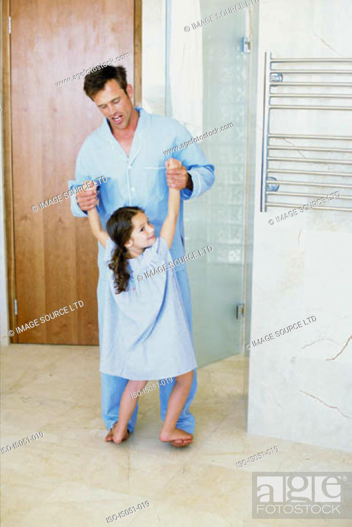 Stock Photo: Father and daughter having fun in the bathroom.