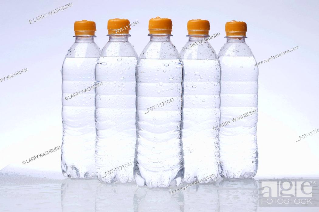 Stock Photo: A row of five full plastic water bottles arranged in a pyramid.